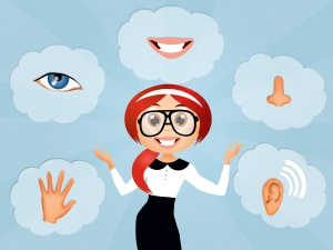 Cartoon image of a woman with red hair, surrounded by images of a human hand, blue eye, mouth, nose, and ear to illustrate the five senses